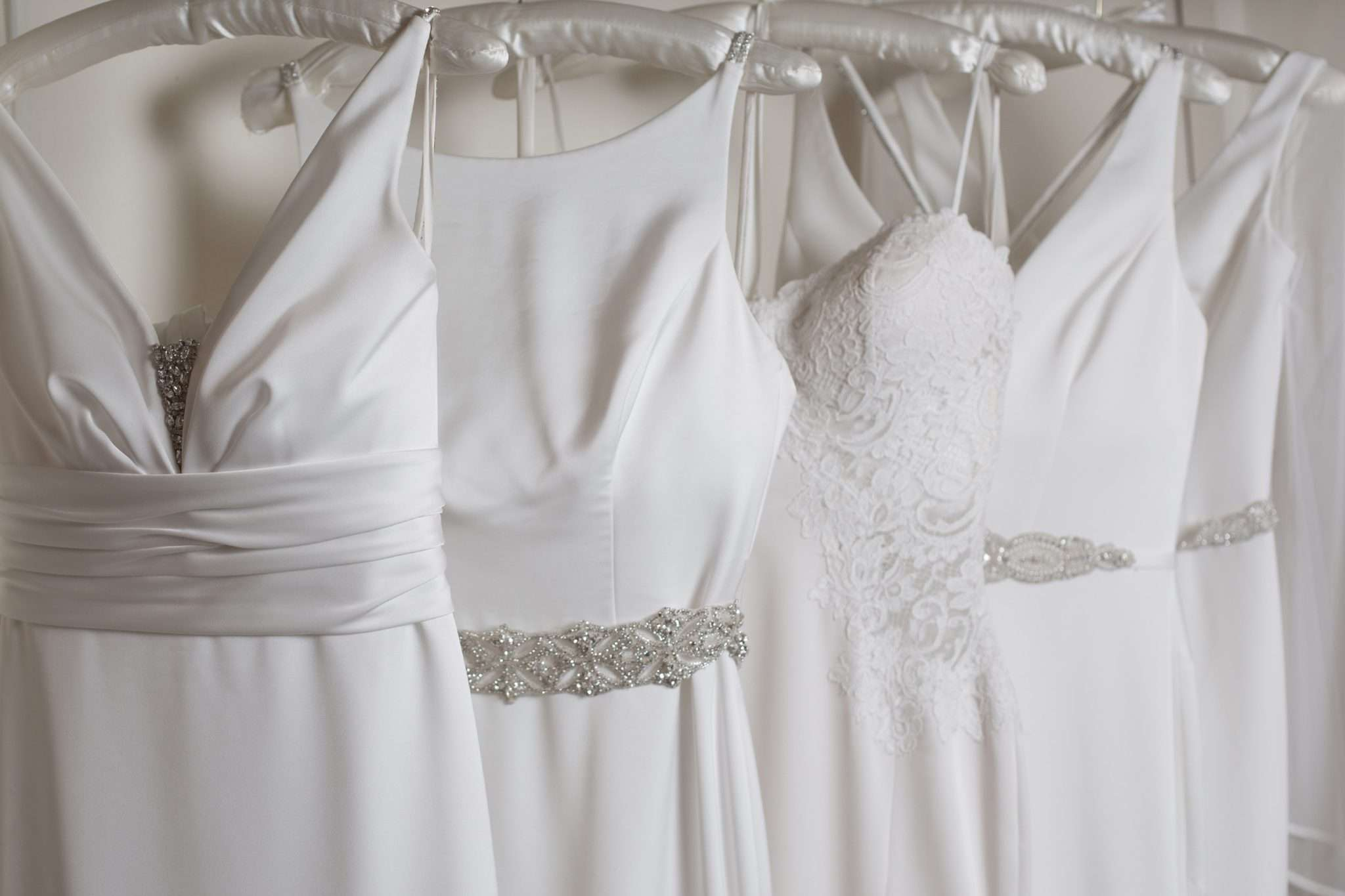 A photo of a row of Wedding Gowns hanging up
