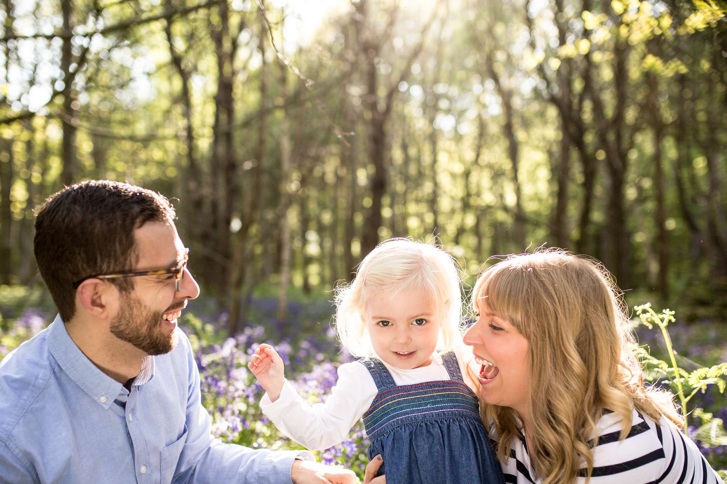 A portrait photo of a family in the woods
