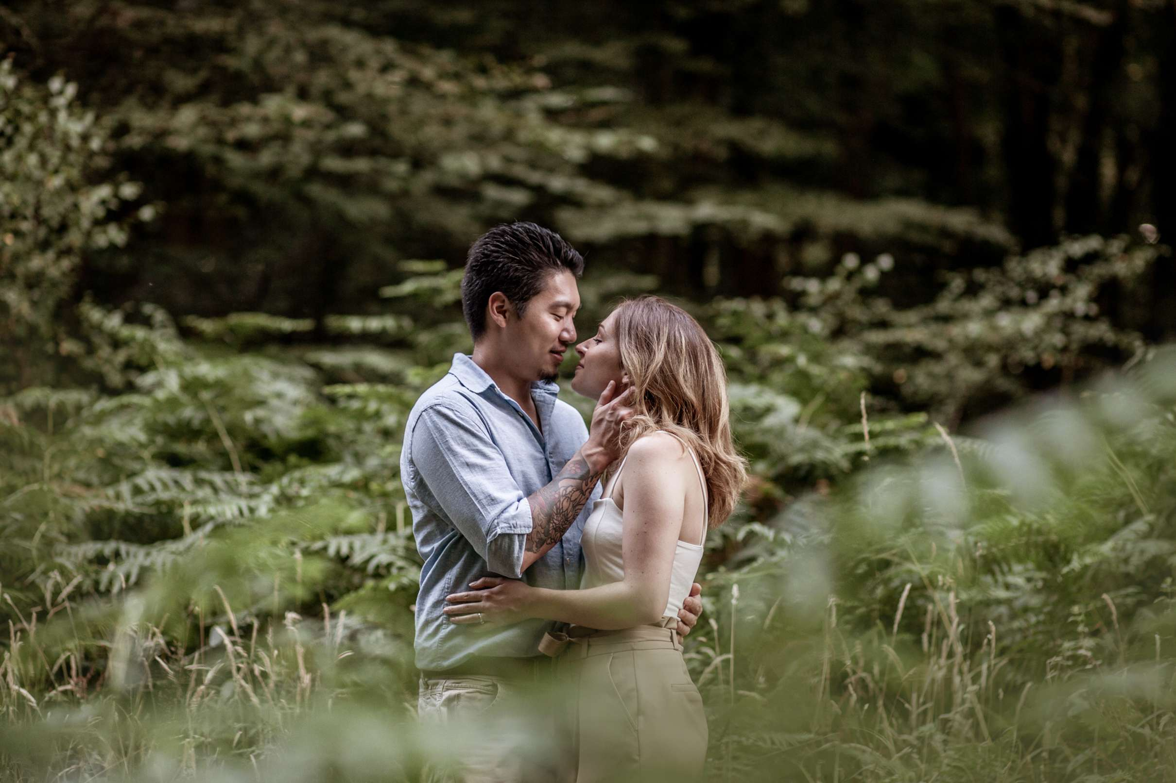 A portrait photo of a couple in the woods having an engagement session in Chichester, West Sussex