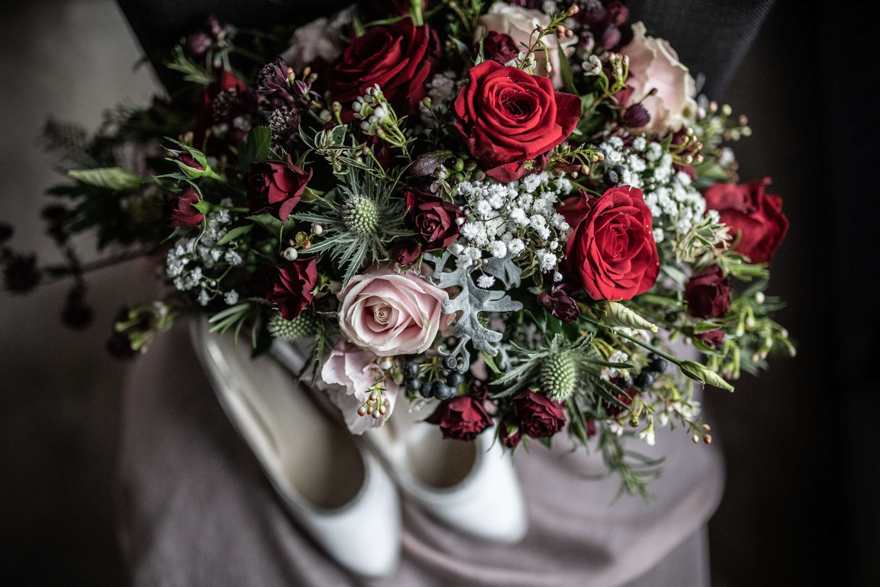 A wedding photo of a bridal bouquet and shoes. Taken in Chichester, Sussex