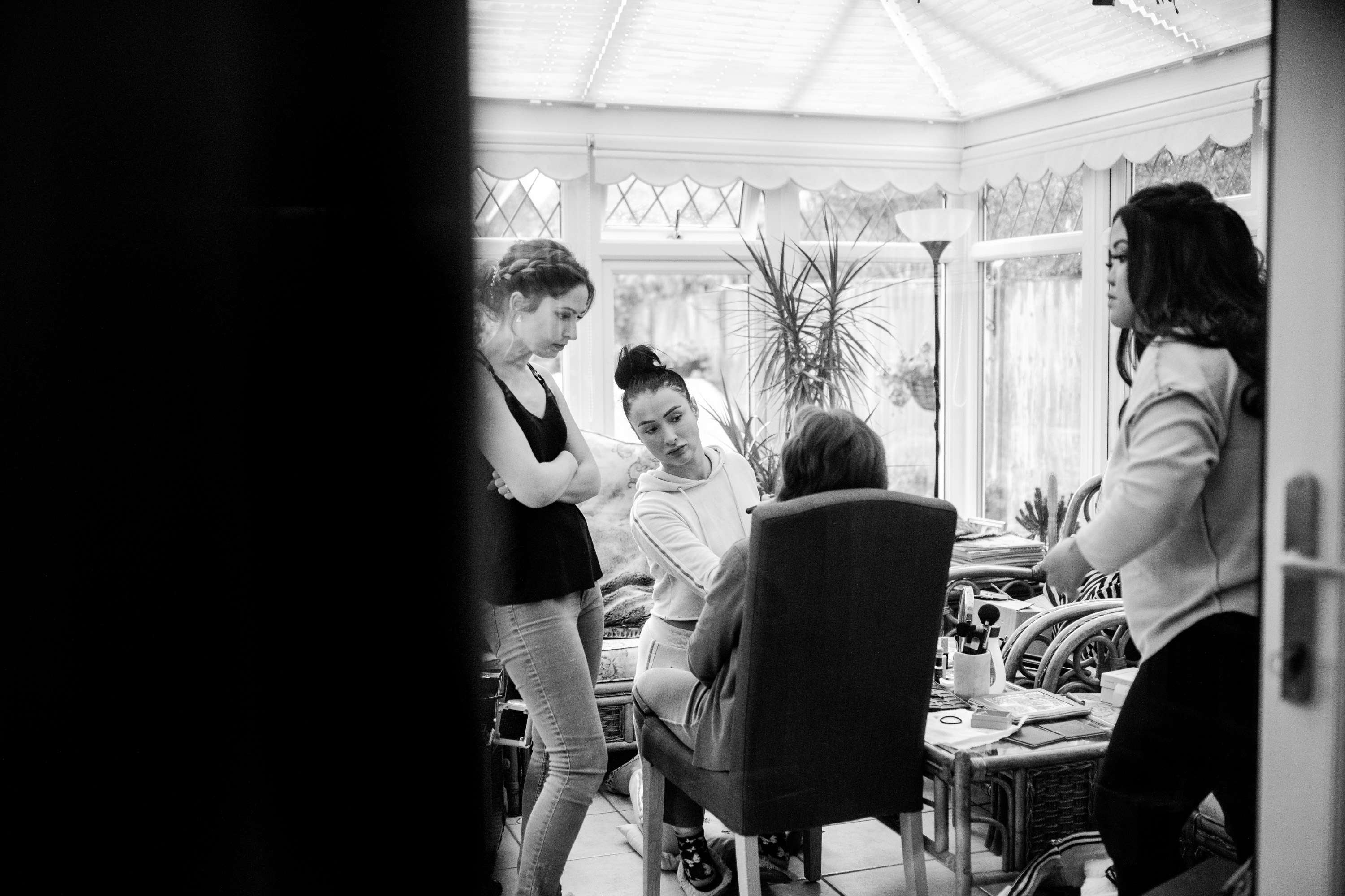 A wedding photo of the bride and bridesmaids getting ready on the wedding morning. Taken in Chichester, Sussex