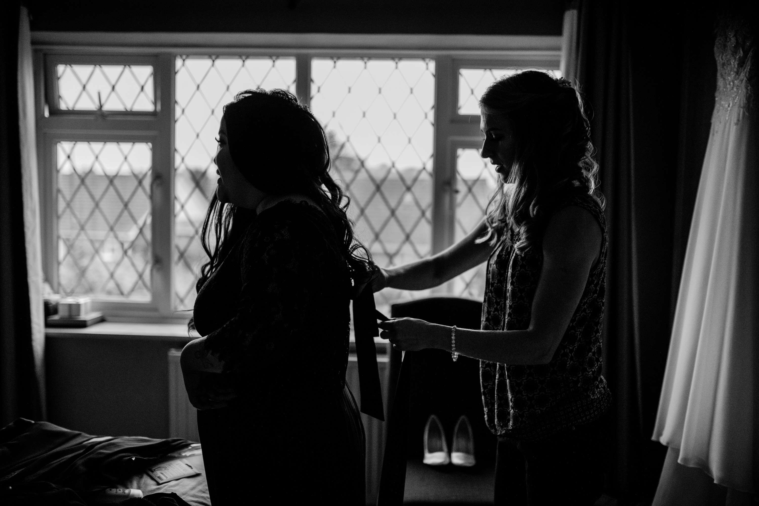 A wedding photo of the bridesmaids getting ready. Taken in Chichester, Sussex