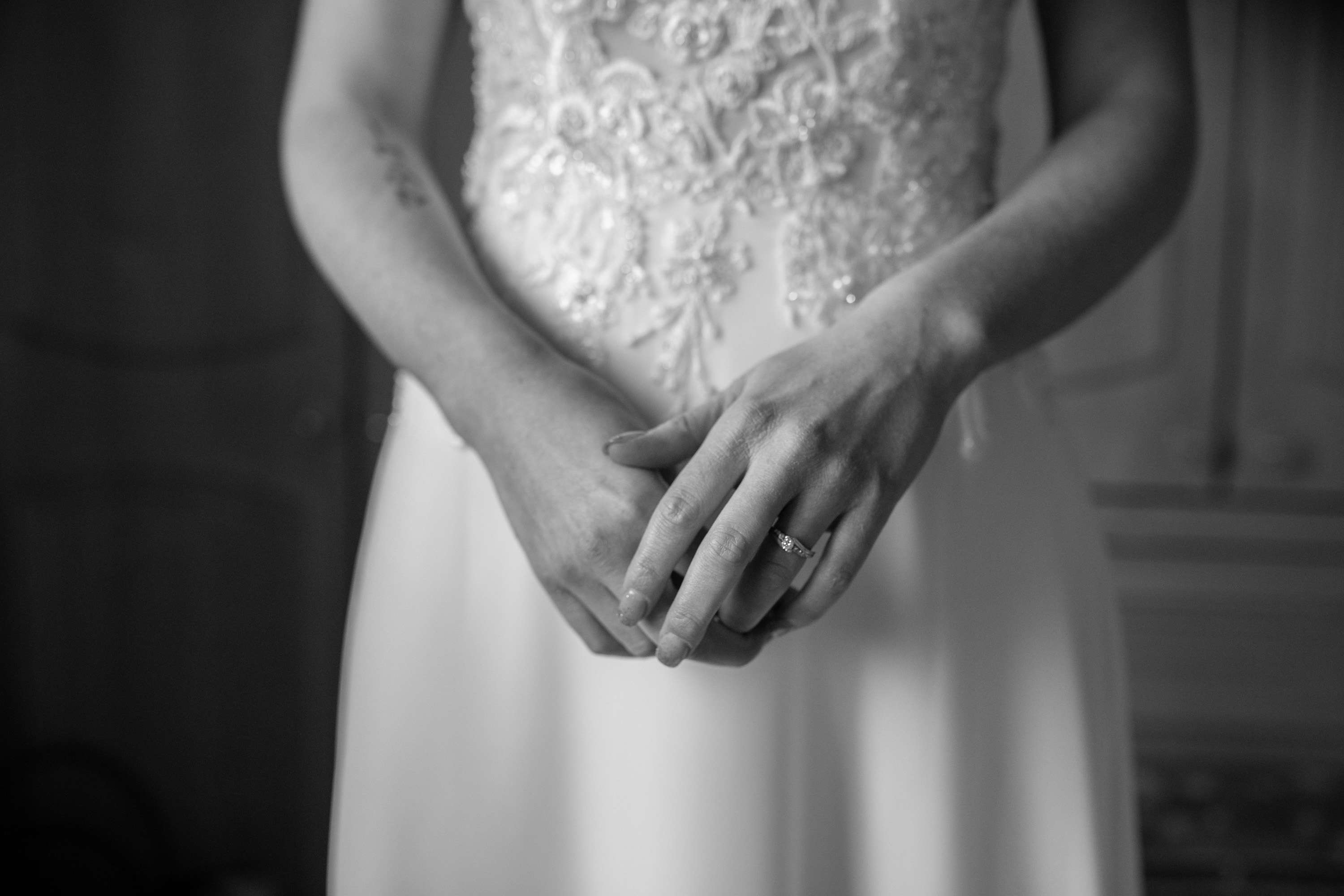 A black and white wedding photo of the bride's hands. Taken in Chichester, Sussex