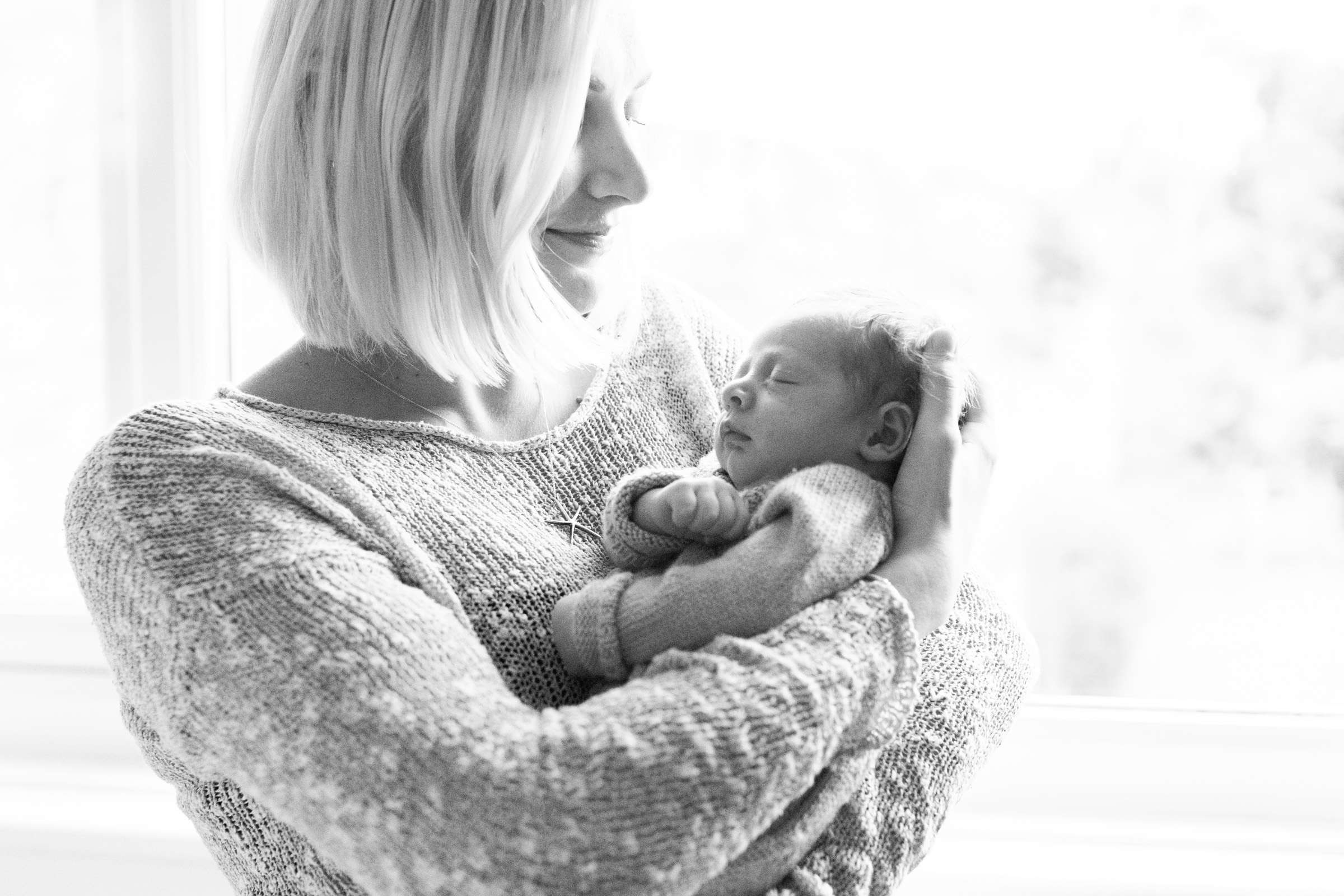 A family portrait photo of a Newborn baby and mother at home in Chichester