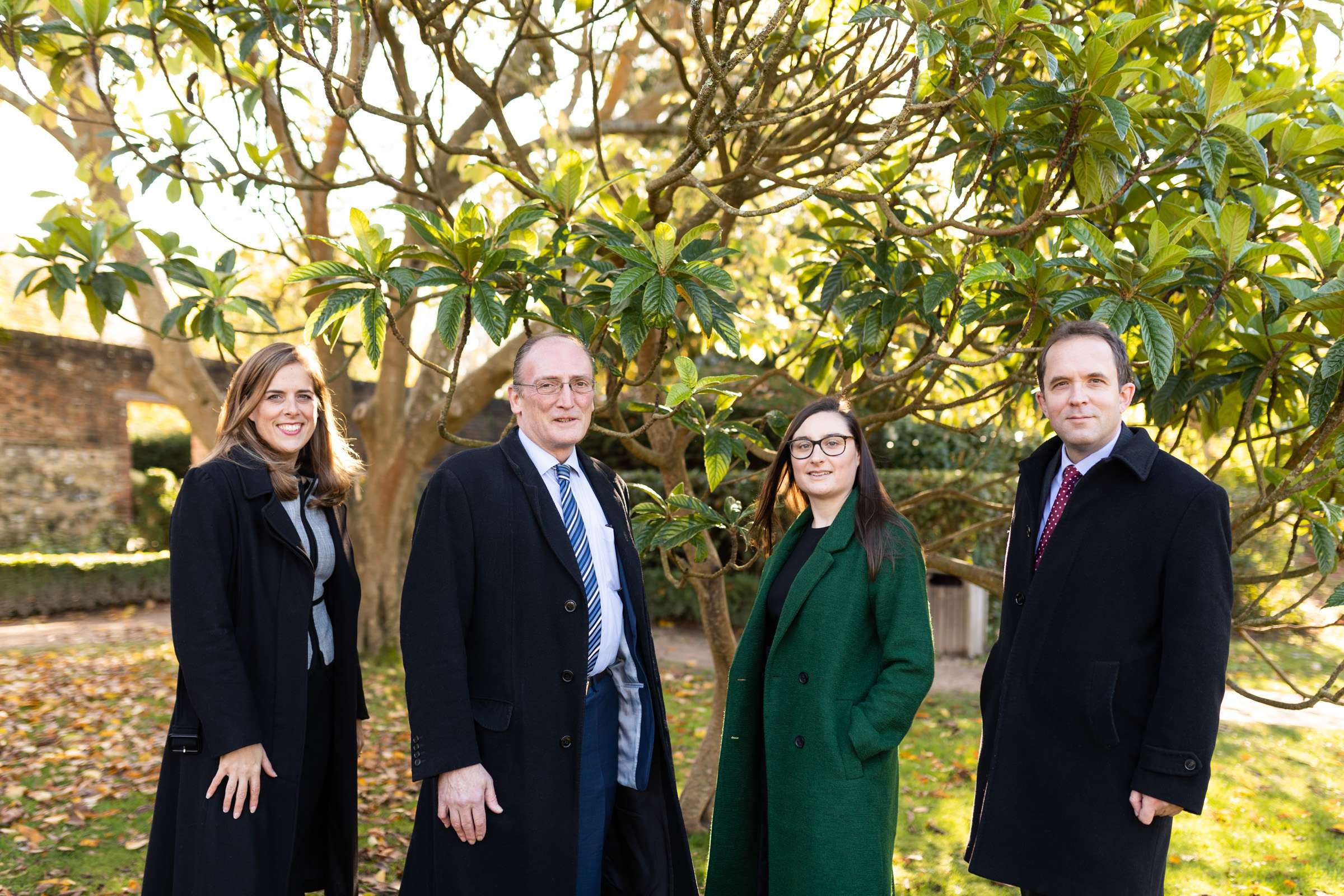 headshot portrait of four male and female professionals taken in Chichester, West Sussex